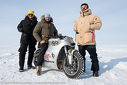 "Event producer Dmitry Khitrov on Yaroslav Tatarinov's custom Kawasaki 1350 GTR beside the famous Russian movie actor Vladimer Yaglych (yellow hat) and Russian rapper Levan (formally known as ""L1"" with 2-million IG followers) at the Baikal Mile Ice Speed Festival. Maksimiha, Siberia, Russia. Saturday, February 29, 2020. Photography ©2020 Michael Lichter."