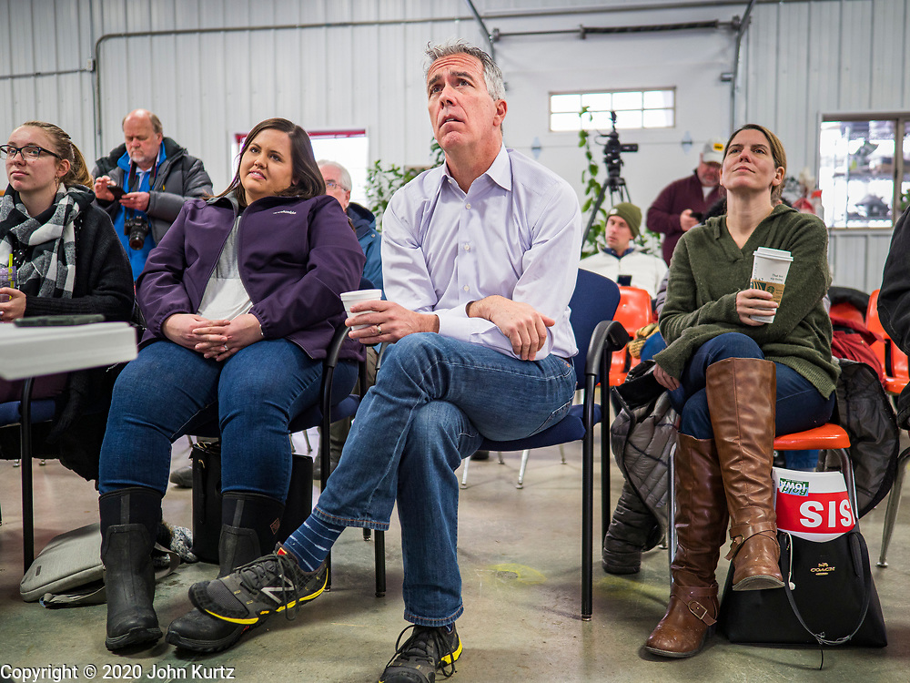 "24 JANUARY 2020 - POLK CITY, IOWA: JOE WALSH, center, listens to a program about regenerative agriculture on a farm in Polk City, northwest of Des Moines. Walsh, a conservative radio personality, former Republican congressman, and one time supporter of Donald Trump is now challenging Trump for the Republican nomination for the US Presidency. During his appearance in Polk City, Walsh said Trump is unfit to be the President because he is a ""cheater,"" a climate change denier, and a ""threat"" to the United States.      PHOTO BY JACK KURTZ"