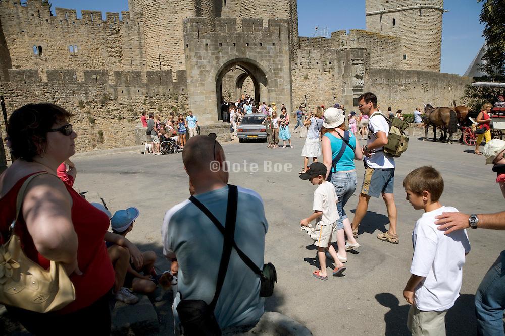 families outside a popular tourist destination France
