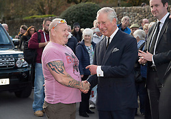 The Prince of Wales meets resident Shaun Edwards at the Aberfan Memorial Garden in Aberfan, Wales on the 50th anniversary of the tragedy.