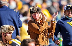 Oct 31, 2020; Morgantown, West Virginia, USA; A West Virginia Mountaineers fan cheers during the fourth quarter against the Kansas State Wildcats at Mountaineer Field at Milan Puskar Stadium. Mandatory Credit: Ben Queen-USA TODAY Sports