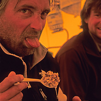 EXPEDITION. Michael Graber show feelings about breakfast in base camp for big wall expedition to climb Rakekniven Spire in Queen Maud Land, Antarctica.