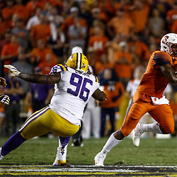 Sep 23, 2017; Baton Rouge, LA, USA; Syracuse Orange running back Dontae Strickland (4) runs past LSU Tigers defensive end Glen Logan (96) during the fourth quarter of a game at Tiger Stadium. LSU defeated Syracuse 35-26. Mandatory Credit: Derick E. Hingle-USA TODAY Sports