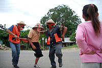 """MEXICO, Veracruz, Tantoyuca, Oct 27- Nov 4, 2009. Watching """"cuanegros"""" dancers, a local countryside specialty. """"Xantolo,"""" the Nahuatl word for """"Santos,"""" or holy, marks a week-long period during which the whole Huasteca region of northern Veracruz state prepares for """"Dia de los Muertos,"""" the Day of the Dead. For children on the nights of October 31st and adults on November 1st, there is costumed dancing in the streets, and a carnival atmosphere, while Mexican families also honor the yearly return of the souls of their relatives at home and in the graveyards, with flower-bedecked altars and the foods their loved ones preferred in life. Photographs for HOY by Jay Dunn."""