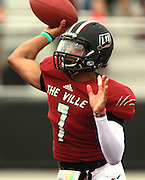 Lindenwood University - Belleville QB Anthony Dorsey (7) throws in the first half of their Homecoming Game against the Menlo College Oaks.