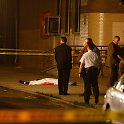 Crime scene investigate the body of a man who was shot dead by an NYPD Officer in Bedstuy, Brooklyn on Saturday, July 12, 2008.