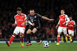 Arsenal's Alex Oxlade-Chamberlain (left) and Bayern Munich's Franck Ribery battle for the ball
