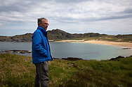 GP Dr David Binnie pictured at Kiloran Bay on the the Inner Hebridean island of Colonsay on Scotland's west coast.  The island is in the council area of Argyll and Bute and has an area of 4,074 hectares (15.7 sq mi). Aligned on a south-west to north-east axis, it measures 8 miles (13 km) in length and reaches 3 miles (4.8 km) at its widest point, in 2019 it had a permanent population of 136 adults and children.