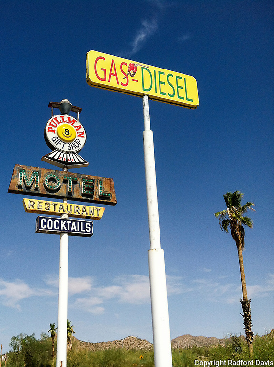 Motel and gas signs along the highway in Arizona.