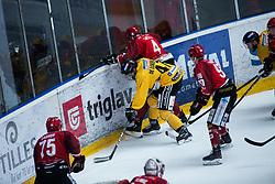 TAVZELJ Tadej vs Lukas De Lorenzo during Alps Hockey League match between HC Pustertal and HDD SIJ Jesenice, on April 3, 2019 in Ice Arena Podmezakla, Jesenice, Slovenia. Photo by Peter Podobnik / Sportida