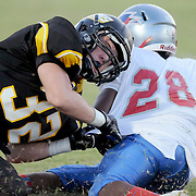 Pender's Justin Hooper is tackled by a Topsail High School player Friday August 30, 2013 at Topsail High School. (Jason A. Frizzelle) This collection of images is from the 2013 High School Football in the Cape Fear region.
