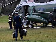 """The military aide walks to Marine One with """"the football"""" for President Donald Trump on January 25, 2017.<br /> Photo by Dennis Brack"""