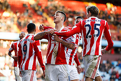Stoke Forward Peter Crouch (ENG) intervenes as Forward Marko Arnautovic (AUT) gestures to the Aston Villa supporters after Defender Geoff Cameron (USA) scores a goal - Photo mandatory by-line: Rogan Thomson/JMP - 07966 386802 - 23/03/2014 - SPORT - FOOTBALL - Villa Park, Birmingham - Aston Villa v Stoke City - Barclays Premier League.