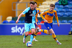 George Maris of Mansfield Town chases down Luke Hannant of Cambridge United - Mandatory by-line: Ryan Crockett/JMP - 20/02/2021 - FOOTBALL - One Call Stadium - Mansfield, England - Mansfield Town v Cambridge United - Sky Bet League Two