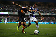 Karl Henry of QPR ® intercepts Aleksandar Mitrovic of Newcastle United. EFL Skybet football league championship match, Queens Park Rangers v Newcastle Utd at Loftus Road Stadium in London on Tuesday 13th September 2016.<br /> pic by John Patrick Fletcher, Andrew Orchard sports photography.