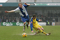 Photo: Lee Earle.<br /> Torquay United v Hartlepool United. Coca Cola League 2. 17/02/2007.Torquay's Lee Mansell (R) slides in on Ritchie Humphreys.