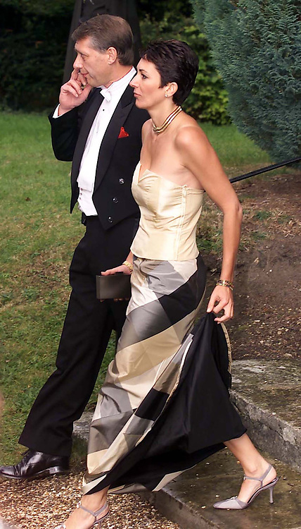 File photo dated 02/09/00 Ghislaine Maxwell, with one of the Duke of York's detectives arriving at the wedding of a former girlfriend Aurelia Cecil at the Parish Church of St Michael in Compton Chamberlayne near Salisbury. British socialite Ghislaine Maxwell is to be charged over her alleged role in the sexual exploitation and abuse of girls by disgraced financier Jeffrey Epstein, the US Attorney's Office for the Southern District of New York said.