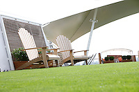 Celebrity Silhouette. .Interior feature photos..Lawn Club giant deck chairs..