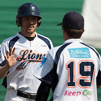 18 April 2010: Chris Goniot of Savigny is congratulated by a teammate during game 1/week 2 of the French Elite season won 8-1 by Savigny (Lions) over Senart (Templiers), at Parc municipal des sports Jean Moulin in Savigny-sur-Orge, France.