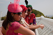 Daniella Issa Helayel; PEARL LOWE; SUSAN BENDER, Glorious Goodwood. Ladies Day. 28 July 2011. <br /> <br />  , -DO NOT ARCHIVE-© Copyright Photograph by Dafydd Jones. 248 Clapham Rd. London SW9 0PZ. Tel 0207 820 0771. www.dafjones.com.