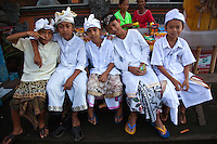 Wearing traditional clothing and hats is the rule rather than the exception in Bali.  This is especially true at festivals and temple visits when wearing sarong is a must to enter.