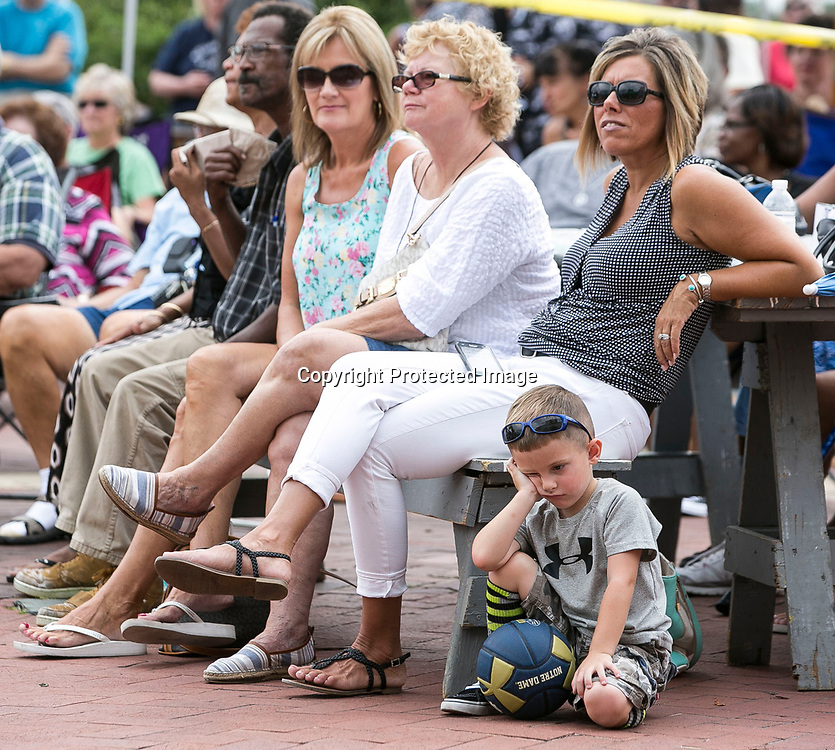 """8/20/2016: Four-year-old Brody Zavitz, of Niles, is not too impressed with the music being played at Fridays by the Fountain as he sits next to his mom, Crystal Zavitz. Billy """"Stix"""" Nicks and the Motown Machine performed on Friday. Tribune Photo/SANTIAGO FLORES<br /> <br /> Four-year-old Brody Zavitz of Niles is not too impressed with the music being played at Friday by the Fountain as he sits next to his mom, Crystal Zavitz.  Billy """"Stix"""" Nicks and the Motown Machine performed on Friday. Tribune Photo/SANTIAGO FLORES"""