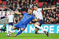 Italy Forward Ciro Immobile (17) and England Defender John Stones (5) battle for the ball during the Friendly match between England and Italy at Wembley Stadium, London, England on 27 March 2018. Picture by Stephen Wright.
