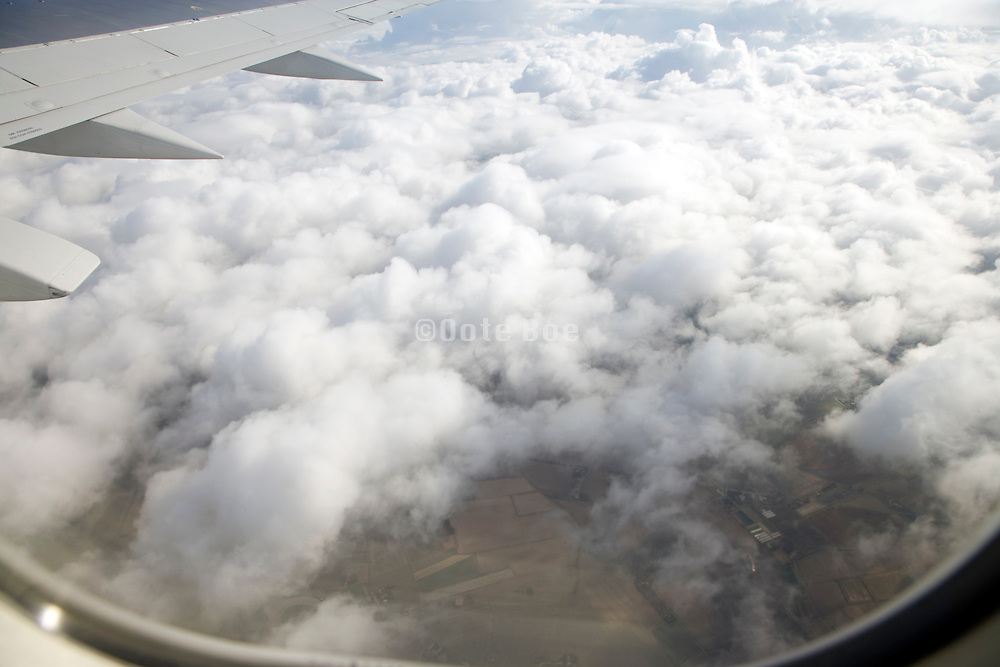 getting above the clouds with still some ground visible