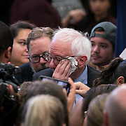 ROCK HILL, SC - JUNE 23: Democratic Senator and presidential candidate,  Bernie Sanders, wipes sweat from his forehead as he greets supporters after a speech at a packed rally inside the gymnasium at Clinton College, a historically black college, before a rally in Rock Hill, SC on June, 22 2019.  (Logan Cyrus for AFP)