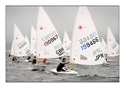 The second day of racing at the World Laser Radial Youth Championships, Largs, Scotland...John Currie GBR 190967 and Kenji Nanri JPN 196499..317 Youth Sailors from 42 different nations compete in the World and European Laser Radial Youth Champiponship from the 17-25 July 2010...The Laser Radial World Championships take place every year. This is the first time they have been held in Scotland and are part of the initiaitve to bring key world class events to Britain in the lead up to the 2012 Olympic Games. ..The Laser is the world's most popular singlehanded sailing dinghy and is sailed and raced worldwide. ..Further media information from .laserworlds@gmail.com.event press officer mobile +44 7866 571932 and +44 1475 675129 .