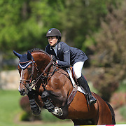 Brianne Goutal riding Nice De Prissey in action during the $100,000 Empire State Grand Prix presented by the Kincade Group during the Old Salem Farm Spring Horse Show, North Salem, New York,  USA. 17th May 2015. Photo Tim Clayton