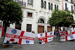 England fans hang banners in the streets prior to the Nations League match at Benito Villamarin Stadium, Seville.