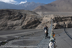 Bear Haughton riding across a narrow suspension bridge over the Kali Gandaki River on day-5  of our Himalayan Heroes adventure riding from Kalopani through the Mustang District to our highest elevation of the trip at over 12,000' when we reached Muktinath, Nepal. Saturday, November 10, 2018. Photography ©2018 Michael Lichter.