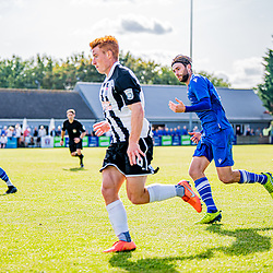Tom Smith takes the ball for Bath City down the wing