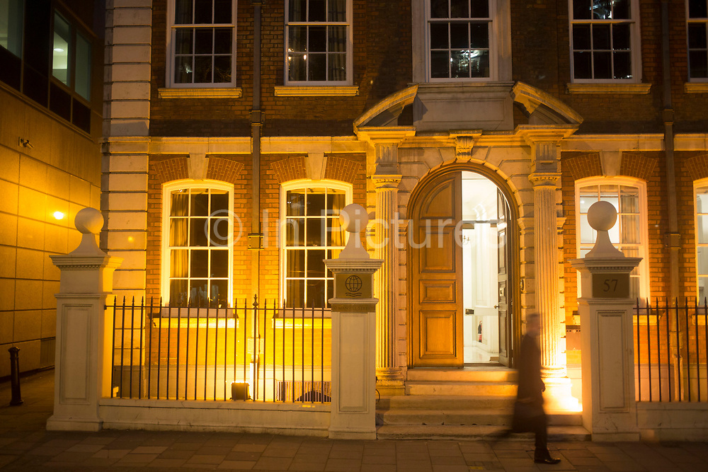 Confused architectural style on a street on Minories at night. Mixing classic English Georgian styles with more European architecture influences.