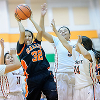 Gallup Bengal Erika Trujillo (32) secures a rebound from the Wingate Bears during the Wingate Holiday Classic girls basketball tournament at Wingate High School Friday.