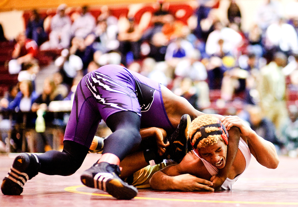 (staff photo by Matt Roth)..Owings Mills's Taran Carr defeated Pikesville's Kion Wright in the 145 championship match during the Baltimore County Wrestling Championships at New Town High School Saturday, February 20, 2010.