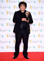 Bong Joon-ho in the press room after winning the award for Best Film Not In The English Language and Best Original Screenplay at the 73rd British Academy Film Awards held at the Royal Albert Hall, London.