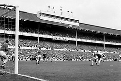 File photo dated 10-08-1968 of Arsenal goalkeeper Bob Wilson (left) prepares himself to make a save as Tottenham Hotspur's Martin Chivers (right) beats Arsenal's Terry Neill (second right) to a header, watched by Arsenal's Frank McLintock (second left) during the game at White Hart Lane
