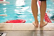 Star Aquatics & Fitness swim coach Jason Wong overlooks his student's technique on the pool deck at the Star Aquatics center in Milpitas, Calif., on Sept. 20, 2012.  Photo by Stan Olszewski/SOSKIphoto.