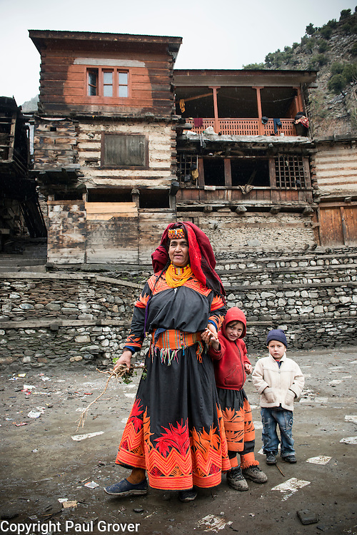 Bumburet, Chitral District,Pakistan.Pic Shows A Kalash woman and children in the Kalash village in the valley of Bumburet