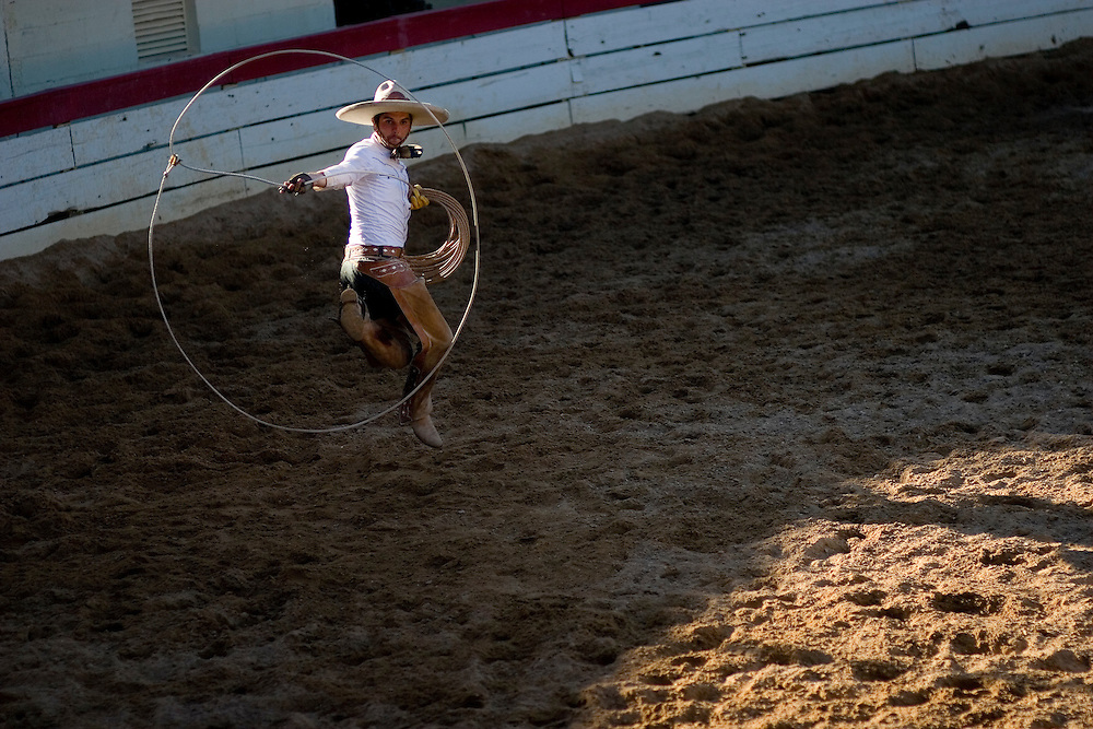Julia Robinson photo.Charros earn extra points for their team in the Mangana a Pie by their extravagant roping techniques and flourishes, called florins.