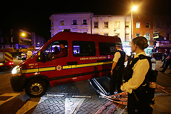 "A London Fire Brigade vehicle passes through a police cordon at Finsbury Park in north London, where one person has been arrested after a vehicle struck pedestrians, leaving ""a number of casualties""."