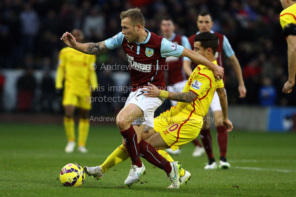 Philippe Coutinho of Liverpool looks to tackle Scott Arfield of Burnley. Barclays Premier league match, Burnley v Liverpool at Turf Moor in Burnley, Lancs on Boxing Day, Friday 26th December 2014.<br /> pic by Chris Stading, Andrew Orchard sports photography.