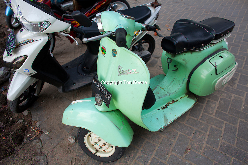 small motorbicycles are the main transport for people at Bali, Indonesia