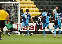 Photo: Leigh Quinnell.<br /> Notts County v Wycombe Wanderers. Coca Cola League 2. 12/08/2006. Notts Countys Junior Mendes slots home his goal past wycombes keeper Ricardo Batista.