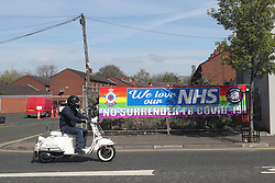 A sign in the loyalist village area of South Belfast, outside the City Hospital which reads No Surrender to Covid-19.