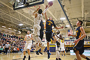 Apple Valley's Tyus Jones (21) and Prior Lake's Jason Faul (31) go up for a rebound during the second half of the basketball game between Prior Lake and Apple Valley at Prior Lake High School, Friday, January 24, 2014.