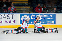 KELOWNA, CANADA - MARCH 28: Colten Martin #8 and Tyrell Goulbourne #12 of the Kelowna Rockets stretch on the ice during warm up against the Tri-City Americans for game 5 of the first round of WHL playoffs on March 28, 2014 at Prospera Place in Kelowna, British Columbia, Canada.   (Photo by Marissa Baecker/Shoot the Breeze)  *** Local Caption *** Colten Martin; Tyrell Goulbourne;
