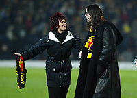 30/11/2004 - Watford v Portsmouth - Carling Cup - Quarter Final<br />Holding Watford scarves, Ozzy and Sharon Osbourne are announced onto the pitch to make a raffle draw and to support their 'X-Factor' Watford fan Tabby<br />Jed Leicester/Back Page Images